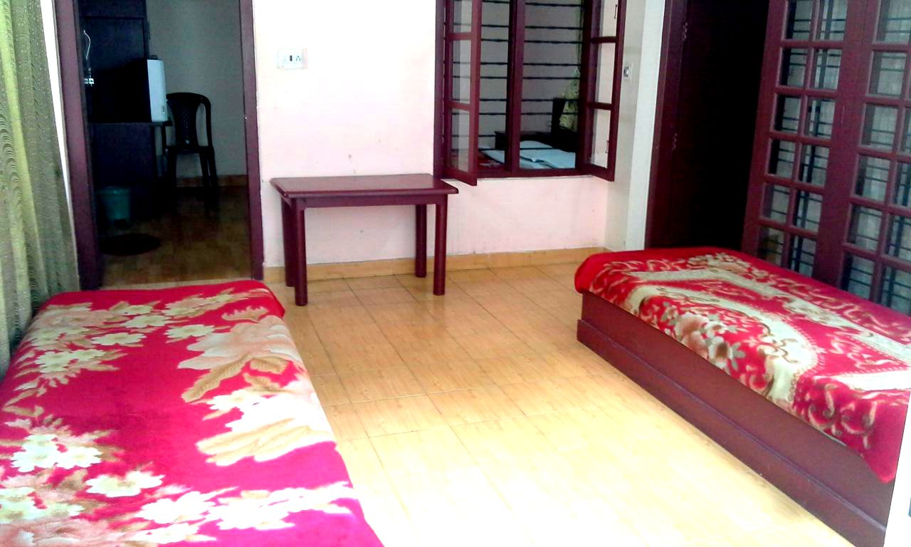 Munnar Greens Stay Cottage Bedroom